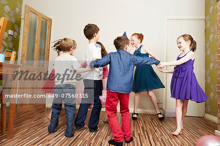 Children dancing at birthday party Stock Photo - Premium Royalty-Free, Image code: 649-07560315