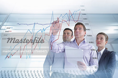 Business colleagues discussing graphs and charts seen on interactive display Stock Photo - Premium Royalty-Free, Image code: 649-07560471