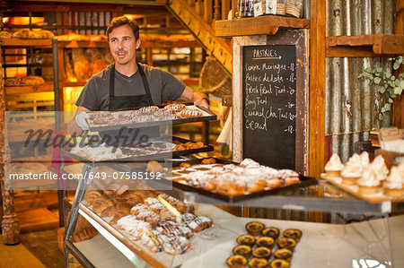 Mature man holding tray of fresh pastries Stock Photo - Premium Royalty-Free, Image code: 649-07585192