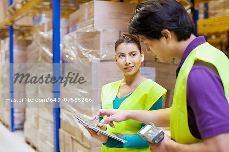 Male and female workers using digital tablet in distribution warehouse Stock Photo - Premium Royalty-Free, Image code: 649-07585266