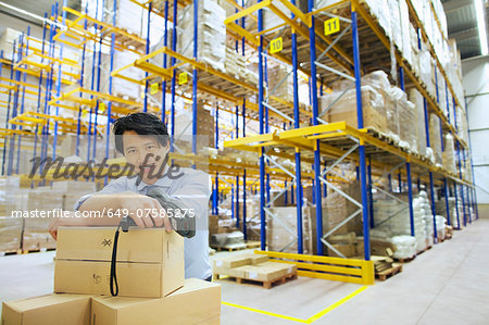 Portrait of male manager in distribution warehouse Stock Photo - Premium Royalty-Free, Image code: 649-07585275