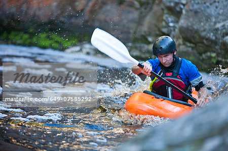 Mid adult man kayaking on river rapids Stock Photo - Premium Royalty-Free, Image code: 649-07585292