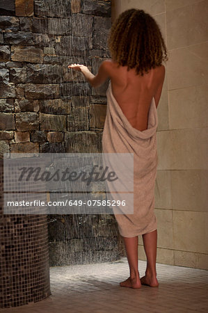Young woman checking shower water in spa Stock Photo - Premium Royalty-Free, Image code: 649-07585296