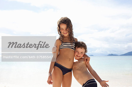 Brother and sister standing on beach in Seychelles Stock Photo - Premium Royalty-Free, Image code: 649-07585547