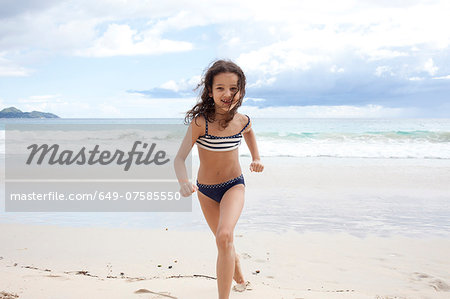 Girl running on beach in Seychelles Stock Photo - Premium Royalty-Free, Image code: 649-07585550