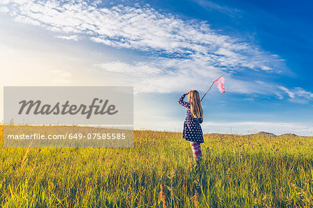 Girl carrying butterfly net in spring meadows, Reykjavic, Iceland Stock Photo - Premium Royalty-Free, Image code: 649-07585585