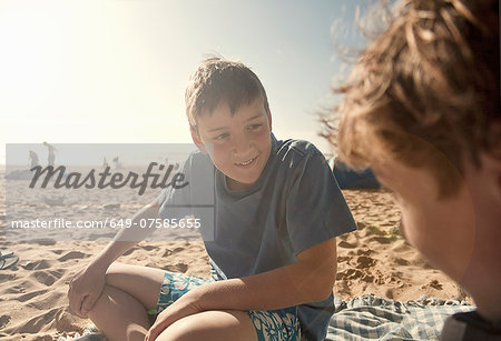 Boys sitting on beach Stock Photo - Premium Royalty-Free, Image code: 649-07585655