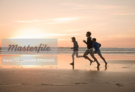 Mother and sons running on beach Stock Photo - Premium Royalty-Free, Image code: 649-07585658