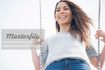 Mid adult woman having fun on park swing Stock Photo - Premium Royalty-Free, Image code: 649-07585719