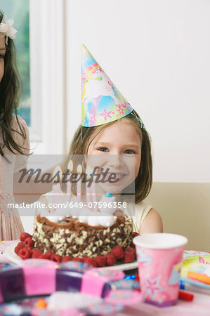 Portrait of young girl enjoying her birthday party Stock Photo - Premium Royalty-Free, Image code: 649-07596358