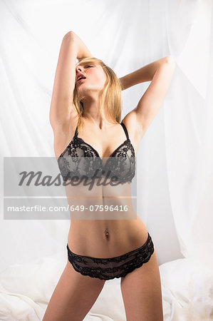 Young woman wearing black lingerie Stock Photo - Premium Royalty-Free, Image code: 649-07596416