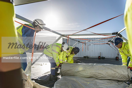 Emergency Response Team workers erecting tent control centre Stock Photo - Premium Royalty-Free, Image code: 649-07596617