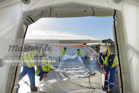 Emergency Response Team workers erecting tent control centre Stock Photo - Premium Royalty-Free, Image code: 649-07596618