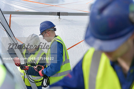 Emergency Response Team workers erecting tent control centre Stock Photo - Premium Royalty-Free, Image code: 649-07596622