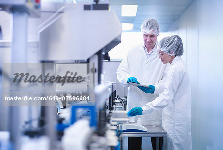 Workers inspecting product in pharmaceutical factory Stock Photo - Premium Royalty-Free, Image code: 649-07596684