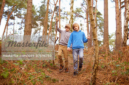 Twin brothers strolling in woods Stock Photo - Premium Royalty-Free, Image code: 649-07596730