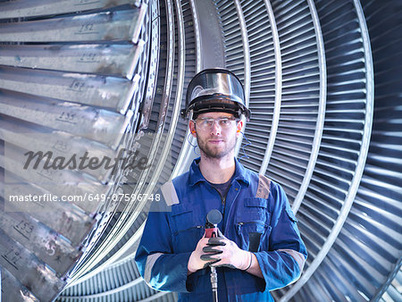 Portrait of apprentice engineer in steam turbine repair workshop Stock Photo - Premium Royalty-Free, Image code: 649-07596748
