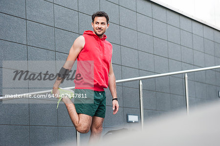 Jogger stretching Stock Photo - Premium Royalty-Free, Image code: 649-07647811
