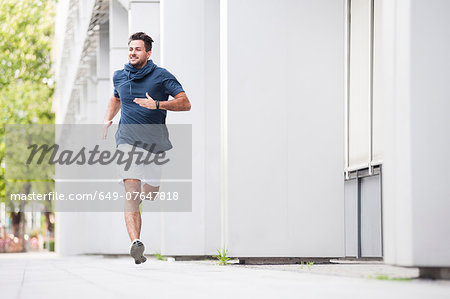 Jogger running Stock Photo - Premium Royalty-Free, Image code: 649-07647818