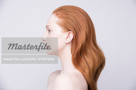 Portrait of young woman, side view, bare shoulders Stock Photo - Premium Royalty-Free, Image code: 649-07647856
