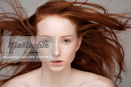 Portrait of young woman, windswept hair Stock Photo - Premium Royalty-Free, Image code: 649-07647873