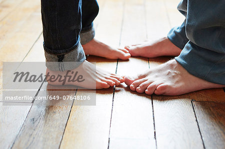 Father and son playing games with feet Stock Photo - Premium Royalty-Free, Image code: 649-07648106