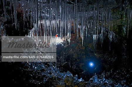Mature man and woman exploring Buri cave, Threngsli, Iceland Stock Photo - Premium Royalty-Free, Image code: 649-07648206