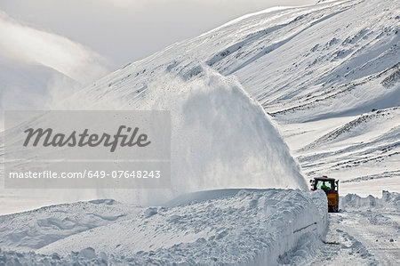 Snow blower clearing road on Oxnadalsheidi close to the town Akureyri , Iceland Stock Photo - Premium Royalty-Free, Image code: 649-07648243