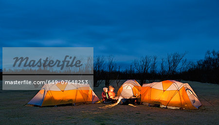 Three friends chatting outside tents at night, Skaftafell, Vatnajokull National park, Iceland Stock Photo - Premium Royalty-Free, Image code: 649-07648253