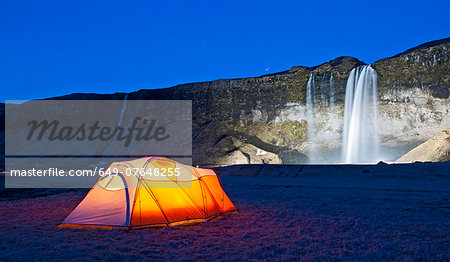 Illuminated tent and Seljalandsfoss waterfall at night, South Iceland Stock Photo - Premium Royalty-Free, Image code: 649-07648255