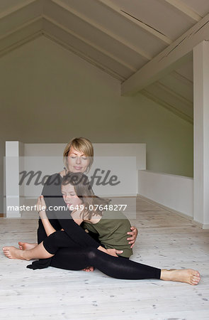 Mother and twelve year old daughter hugging on floor Stock Photo - Premium Royalty-Free, Image code: 649-07648277