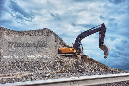 Excavator and mound of construction material Stock Photo - Premium Royalty-Free, Image code: 649-07648413