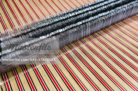 Close up of striped textile on weaving machine in woollen mill Stock Photo - Premium Royalty-Free, Image code: 649-07648501
