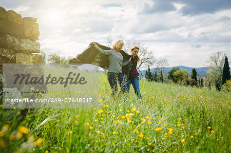 Mother and teenage daughter strolling with blanket Stock Photo - Premium Royalty-Free, Image code: 649-07648517