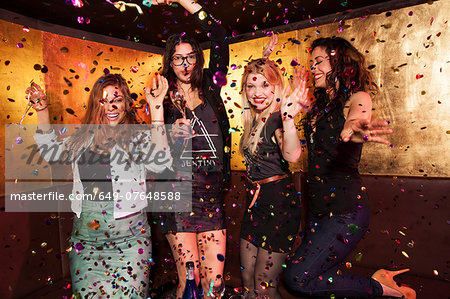 Four female friends partying in nightclub Stock Photo - Premium Royalty-Free, Image code: 649-07648588