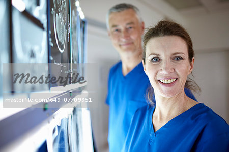 Portrait of radiologists with brain scans Stock Photo - Premium Royalty-Free, Image code: 649-07709951