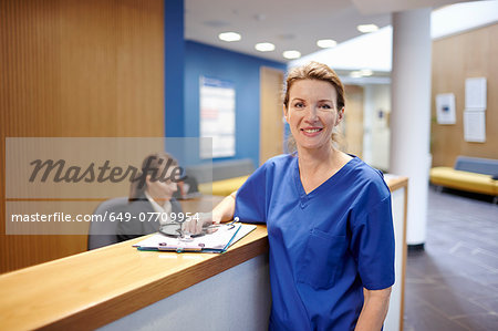Nurse standing in hospital waiting room Stock Photo - Premium Royalty-Free, Image code: 649-07709954
