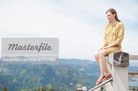 Mid adult woman on viewing platform fence, Wallberg, Tegernsee, Bavaria, Germany Stock Photo - Premium Royalty-Free, Image code: 649-07710094