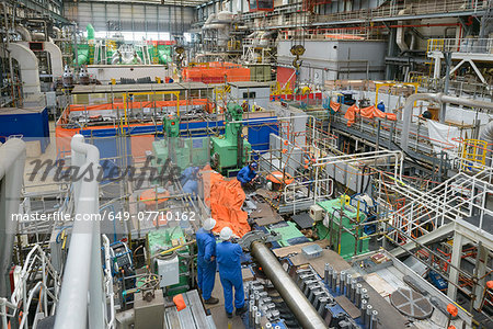 Engineers working on turbine housing repair during power station outage, high angle view Stock Photo - Premium Royalty-Free, Image code: 649-07710162
