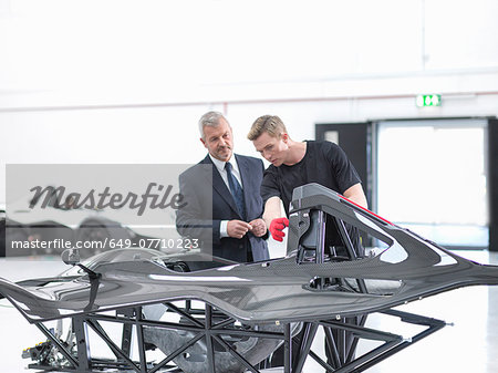 Manager and engineer inspecting carbon fibre body of supercar in sports car factory Stock Photo - Premium Royalty-Free, Image code: 649-07710223