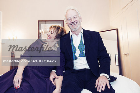 Couple sitting on bed, laughing Stock Photo - Premium Royalty-Free, Image code: 649-07710423