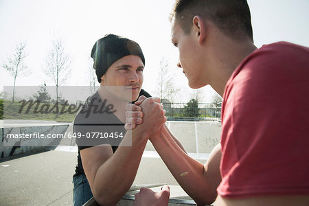 Young men arm-wrestling in skatepark Stock Photo - Premium Royalty-Free, Image code: 649-07710454