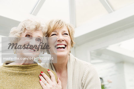 Senior woman with daughter, laughing Stock Photo - Premium Royalty-Free, Image code: 649-07710595