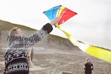 Mid adult man and son preparing to fly kite on beach, Bloemendaal aan Zee, Netherlands Stock Photo - Premium Royalty-Free, Image code: 649-07710719