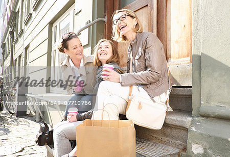 Three generation females drinking takeaway coffee on street Stock Photo - Premium Royalty-Free, Image code: 649-07710766