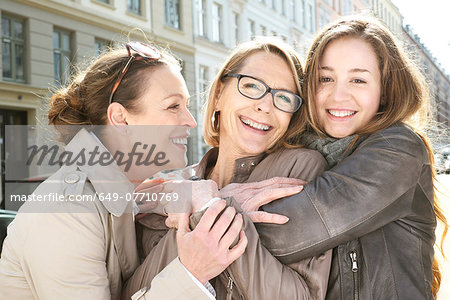 Portrait of three generation females in the city Stock Photo - Premium Royalty-Free, Image code: 649-07710769