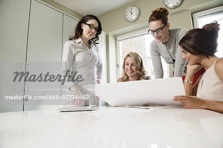 Four female designers looking at blueprint in office Stock Photo - Premium Royalty-Free, Image code: 649-07736462