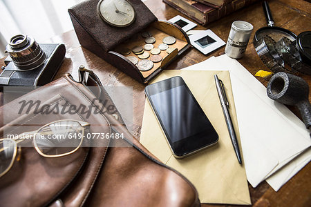Still life of group of vintage objects with smartphone Stock Photo - Premium Royalty-Free, Image code: 649-07736484