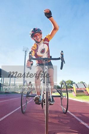 Cyclist at finishing line in para-athletic competition Stock Photo - Premium Royalty-Free, Image code: 649-07736745