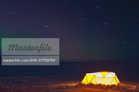 Illuminated tent and northern lights in clear sky, Langjokull, South West Iceland Stock Photo - Premium Royalty-Free, Image code: 649-07736799